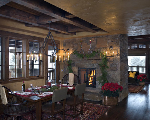 Inspiration For A Rustic Dining Room Remodel In Other With Stone Fireplace Surround