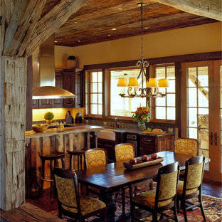 Kitchen/dining room combo - rustic dark wood floor kitchen/dining room combo idea in Other with yellow walls