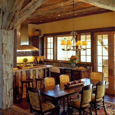Kitchen/dining room combo - rustic dark wood floor kitchen/dining room combo idea in Other with yellow walls