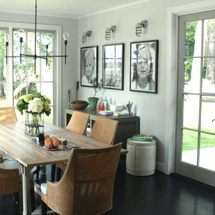 Dining room - rustic dining room idea in Other with gray walls