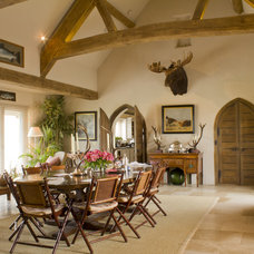 Rustic Dining Room by The Original Book Works Ltd.