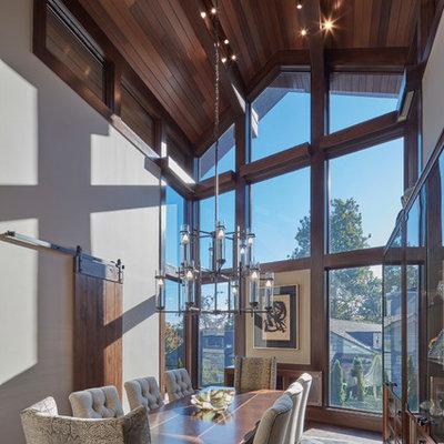 Enclosed dining room - rustic dark wood floor and brown floor enclosed dining room idea in Detroit with beige walls