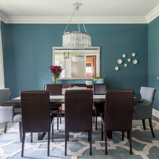 Design ideas for a traditional enclosed dining room in Chicago with blue walls, dark hardwood flooring and no fireplace.