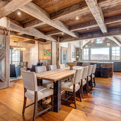 Mountain style medium tone wood floor kitchen/dining room combo photo in Boston with white walls