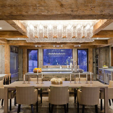 rustic dining room by On Site Management, Inc.