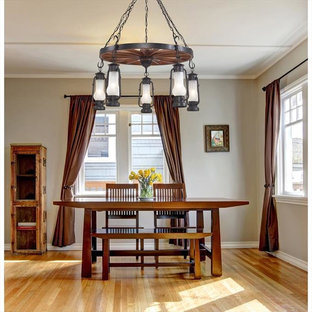 Example of a mid-sized mountain style light wood floor dining room design in New York with beige walls