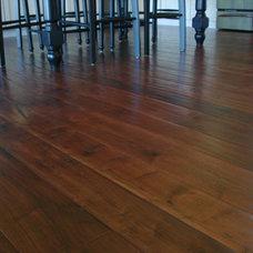 Tropical Dining Room by Plantation Hardwood Floors