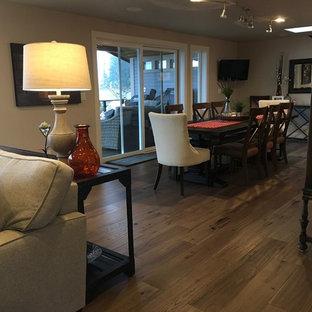 Esempio di una sala da pranzo aperta verso la cucina chic con pareti beige, parquet scuro, camino sospeso e cornice del camino piastrellata