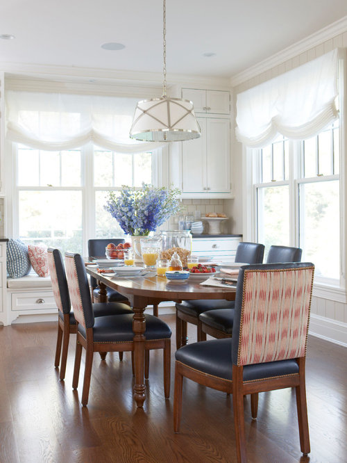 Example Of A Classic Medium Tone Wood Floor And Brown Dining Room Design In New