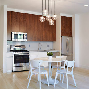 Mid-sized contemporary eat-in kitchen photos - Inspiration for a mid-sized contemporary single-wall light wood floor and white floor eat-in kitchen remodel in New York with an undermount sink, flat-panel cabinets, dark wood cabinets, quartz countertops, gray backsplash, stone slab backsplash, stainless steel appliances and no island