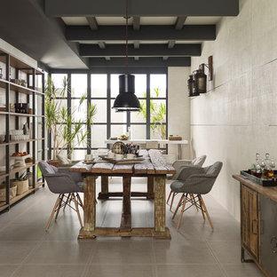 Dining room - industrial porcelain floor and gray floor dining room idea with beige walls