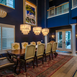 Dining room - traditional medium tone wood floor dining room idea in Tampa with blue walls