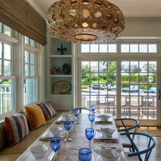 Beach Style Dining Room by Mitchell Wilk Architecture