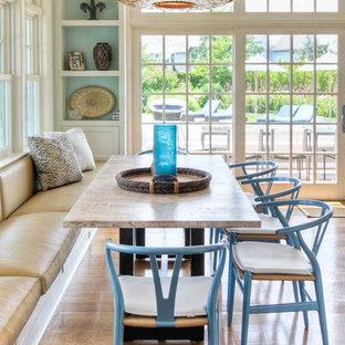 Coastal medium tone wood floor dining room photo in New York