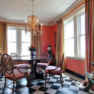 Imagen de comedor clásico, de tamaño medio, cerrado, sin chimenea, con parades naranjas, suelo de mármol y suelo multicolor