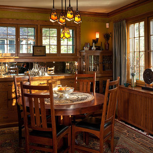 Inspiration for a craftsman dark wood floor enclosed dining room remodel in Minneapolis with no fireplace and brown walls