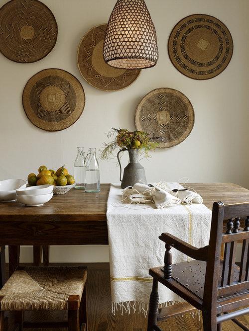 Rustic dark wood floor dining room idea in San Francisco with white walls