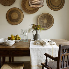 Rustic Dining Room by Jute Interior Design