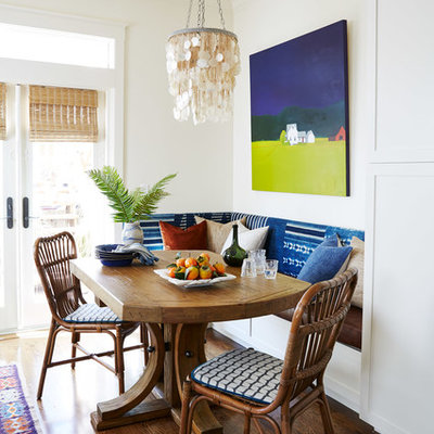 Inspiration for a mid-sized coastal medium tone wood floor and brown floor kitchen/dining room combo remodel in San Francisco with white walls and no fireplace