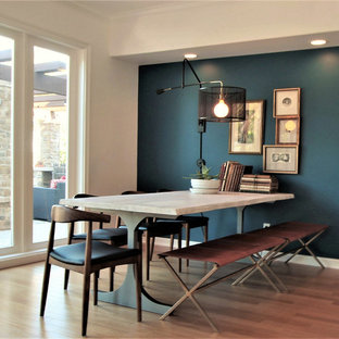 Mid-sized danish bamboo floor and brown floor great room photo in Orange County with blue walls