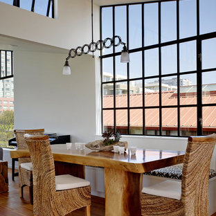Example of a minimalist medium tone wood floor dining room design in San Francisco with white walls