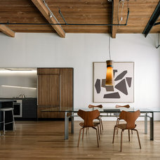 Industrial Dining Room by LINEOFFICE Architecture, Inc