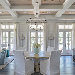 Design ideas for a coastal dining room in Miami with white walls, dark hardwood flooring and no fireplace.