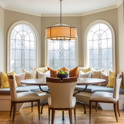 Example of a large transitional medium tone wood floor and brown floor kitchen/dining room combo design in Atlanta with beige walls