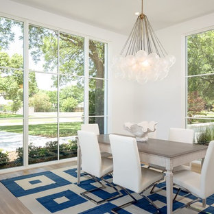 Example of a mid-sized coastal light wood floor and beige floor enclosed dining room design in Dallas with white walls and no fireplace