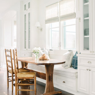 Beach style dark wood floor and brown floor breakfast nook photo in Los Angeles with white walls