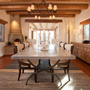 Imagen de comedor de estilo americano, grande, con paredes beige, chimenea de esquina, marco de chimenea de yeso y suelo de baldosas de terracota