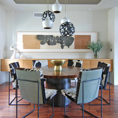 Dining room - contemporary dark wood floor dining room idea in Los Angeles with white walls