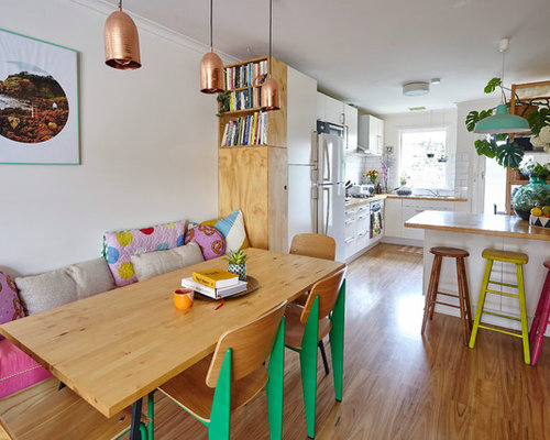 Design Ideas For An Eclectic Open Plan Dining In Melbourne With Medium Hardwood Floors