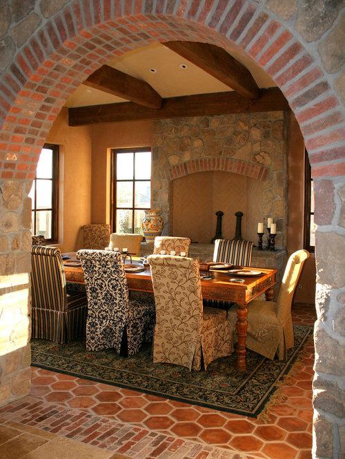 rustic terracotta floor dining room idea in san francisco with orange walls a