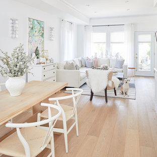 Small danish light wood floor and white floor dining room photo in Other with white walls, a standard fireplace and a wood fireplace surround