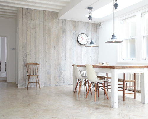Inspiration For A Scandinavian Light Wood Floor And Beige Floor Dining Room  Remodel In London With