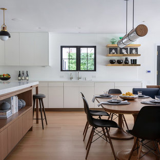 Kitchen/dining room combo - small country light wood floor kitchen/dining room combo idea in New York with white walls and no fireplace