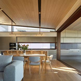 Contemporary open plan dining in Sunshine Coast with beige walls, light hardwood floors and beige floor.