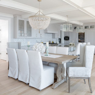 Example of a coastal light wood floor and beige floor great room design in Boston with gray walls