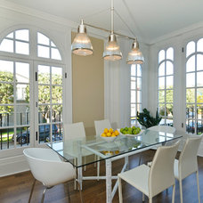 Contemporary Dining Room by Wooden Window