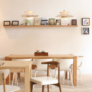 Dining room - contemporary dining room idea in San Francisco with white walls