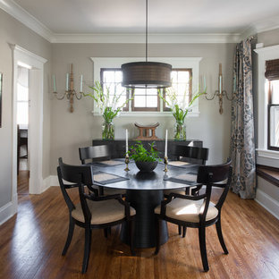 Traditional separate dining room in Minneapolis with grey walls and medium hardwood floors.