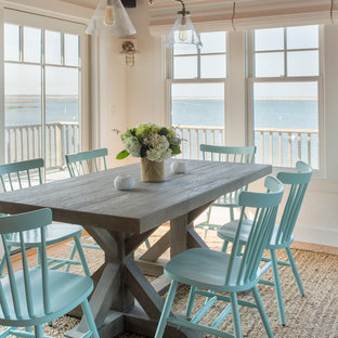 Inspiration for a beach style open plan dining room in Boston with yellow walls and medium hardwood flooring.