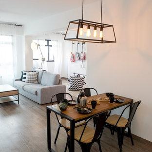 Idee per una sala da pranzo aperta verso la cucina industriale con pareti bianche e pavimento in vinile