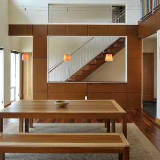Example of a coastal dining room design in Seattle with white walls