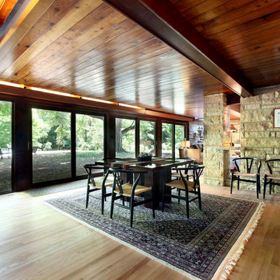 Inspiration for a contemporary light wood floor dining room remodel in Grand Rapids