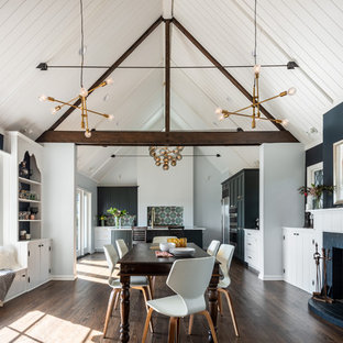 Great room - large farmhouse dark wood floor and brown floor great room idea in Seattle with a standard fireplace, blue walls and a brick fireplace