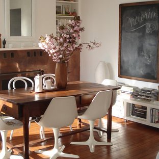 Dining room - shabby-chic style dark wood floor dining room idea in San Francisco with white walls