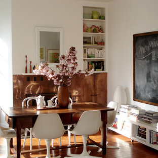 Inspiration for an eclectic medium tone wood floor dining room remodel in San Francisco with white walls