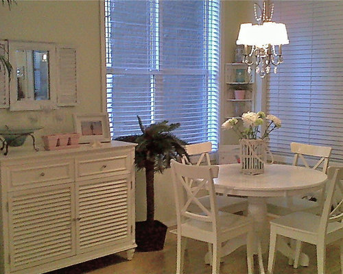 Example Of An Island Style Dining Room Design In Edmonton